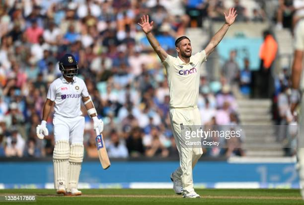 Chris Woakes of England successfully appeals for the wicket of Ajinkya Rahane of India during day four of the Fourth LV= Insurance Test Match between...