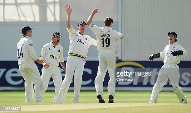 Chris Woakes of Warwickshire celebrates with his teammates after dismissing Martin van Jaarsveld of Kent during the LV County Championship match...