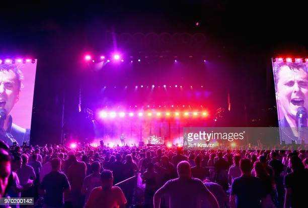 Chris Wolstenholme Dominic Howard and Matt Bellamy of Muse perform on What Stage during day 2 of the 2018 Bonnaroo Arts And Music Festival on June 8...