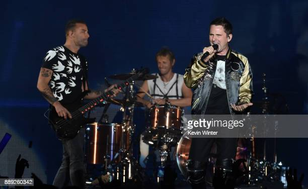Chris Wolstenholme Dominic Howard and Matt Bellamy of Muse perform onstage during KROQ Almost Acoustic Christmas 2017 at The Forum on December 9 2017...