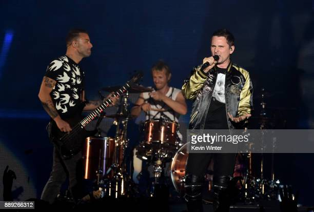 Chris Wolstenholme, Dominic Howard, and Matt Bellamy of Muse perform onstage during KROQ Almost Acoustic Christmas 2017 at The Forum on December 9,...
