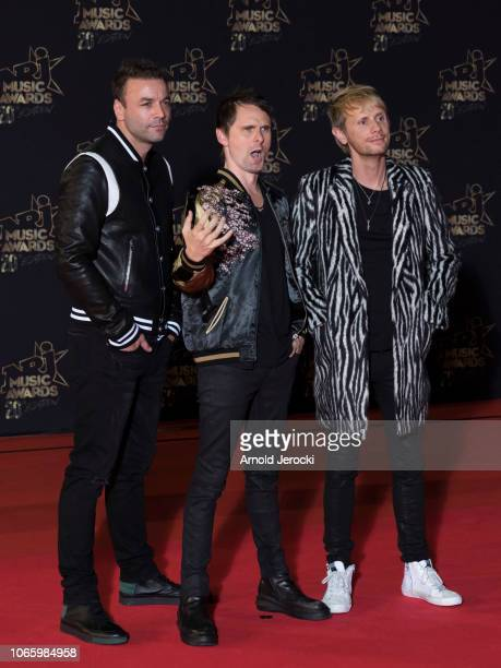 Chris Wolstenholme, Matt Bellamy and Dominic Howard attends the 20th NRJ Music Awards at Palais des Festivals on November 10, 2018 in Cannes, France.