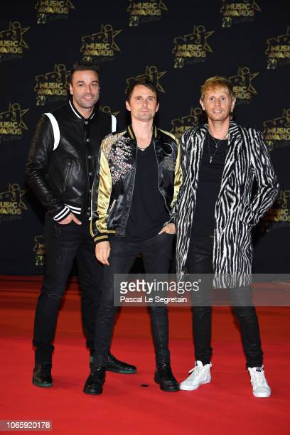 Chris Wolstenholme, Matt Bellamy and Dominic Howard of Muse arrive at the 20th NRJ Music Awards at Palais des Festivals on November 10, 2018 in...