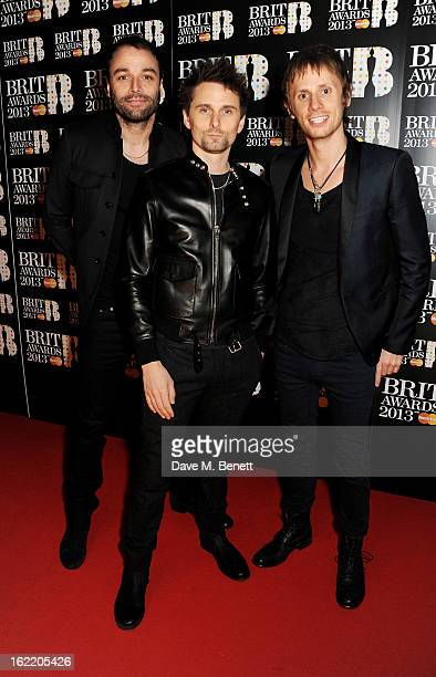 Chris Wolstenholme Matt Bellamy and Dominic Howard of Muse arrive at the BRIT Awards 2013 at the O2 Arena on February 20 2013 in London England