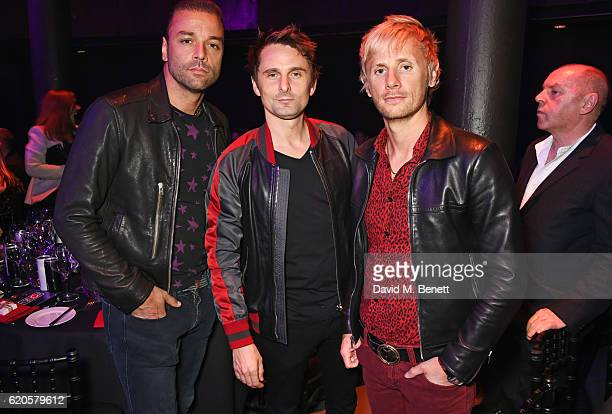 Chris Wolstenholme Matt Bellamy and Dominic Howard of Muse attend a drinks reception at The Stubhub Q Awards 2016 at The Roundhouse on November 2...