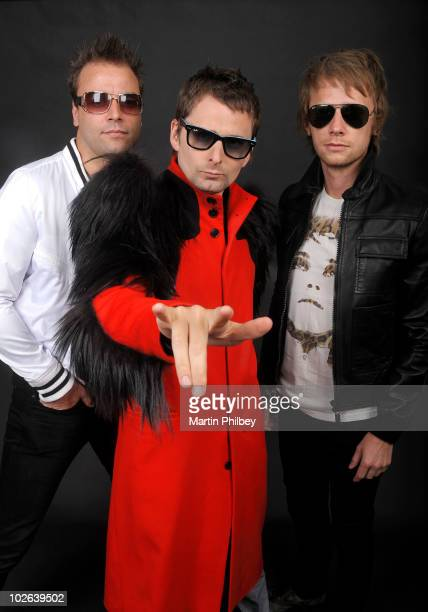 Chris Wolstenholme Matt Bellamy and Dominic Howard of Muse pose for a group portrait backstage at the Big Day Out at Flemington Race Course on...