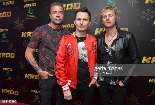 Chris Wolstenholme Matt Bellamy and Dominic Howard of Muse pose backstage during KROQ Almost Acoustic Christmas 2017 at The Forum on December 9 2017...