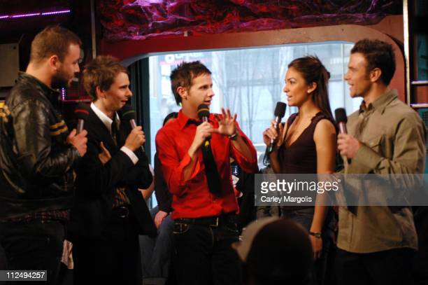 Chris Wolstenholme Matthew Bellamy and Dominic Howard of Muse with Fuse VJs Marianela and Dylan