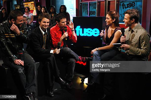 Chris Wolstenholme, Matthew Bellamy and Dominic Howard of Muse with Fuse VJs Marianela and Dylan