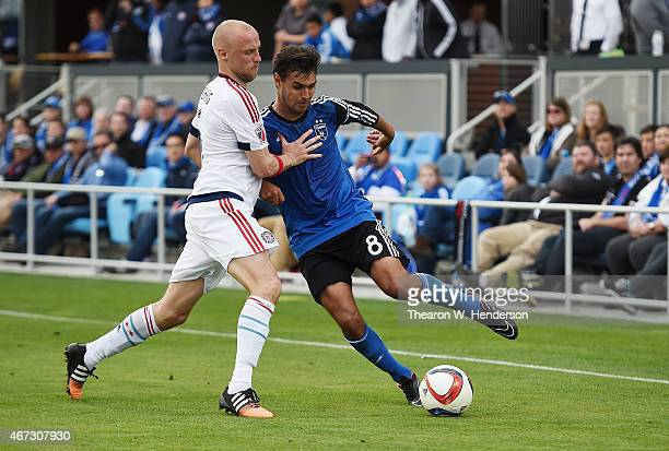 Chris Wondolowski of San Jose Earthquakes battles for control of the ball with Eric Gehrig of Chicago Fire during the second half at Avaya Stadium on...