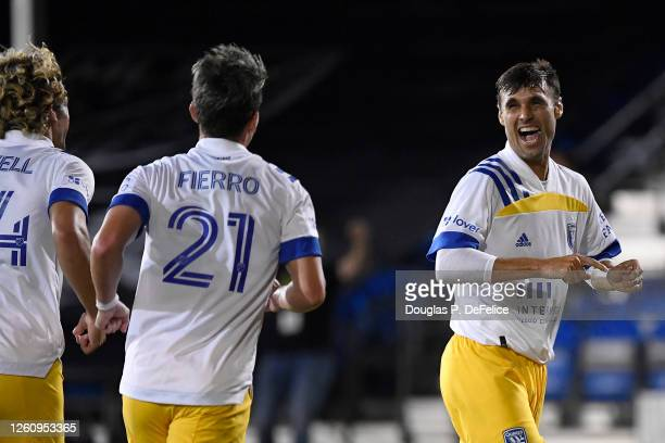 Chris Wondolowski of San Jose Earthquakes celebrates with teammates after scoring the fourth goal of his team during a round of 16 match of the MLS...