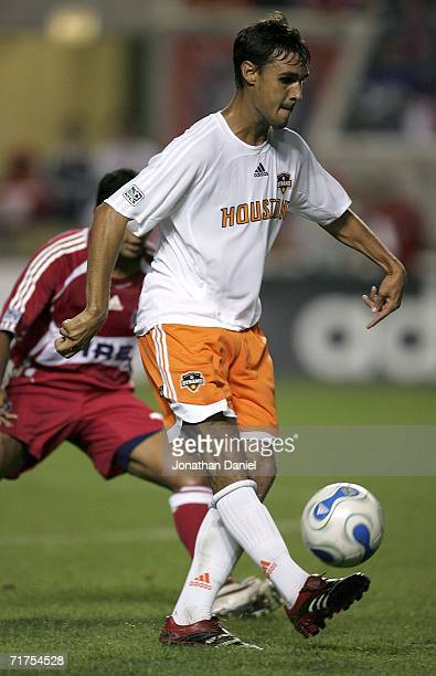 Chris Wondolowski of the Houston Dynamo passes the ball upfield past Diego Gutierrez of the Chicago Fire August 30 2006 at Toyota Park in Bridgeview...