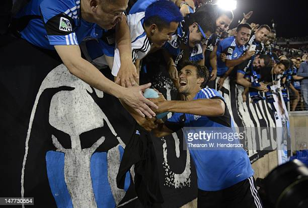 Chris Wondolowski of the San Jose Earthquake celebrates with fans after the Earthquakes defeated the Los Angeles Galaxy 4 to 3 at Stanford Stadium on...