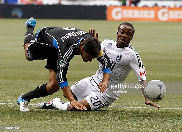 Chris Wondolowski of the San Jose Earthquakes and Dane Richards of the Vancouver Whitecaps FC battle for the ball during their MLS game July 22 2012...