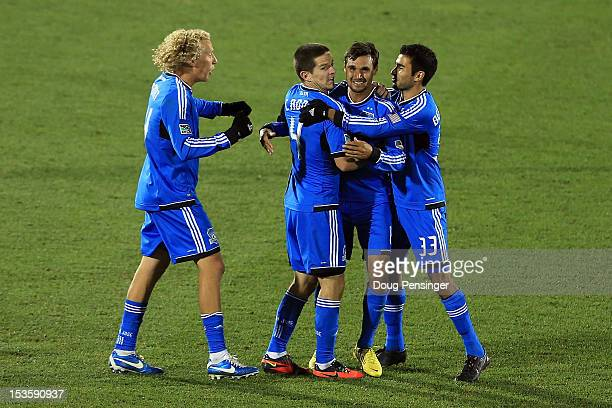 Chris Wondolowski of the San Jose Earthquakes celebrates his goal in the 83rd minute against the Colorado Rapids with Steven Lenhart, Sam Cronin and...