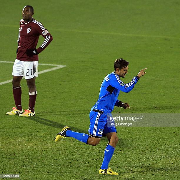Chris Wondolowski of the San Jose Earthquakes celebrates his goal in the 83rd minute as Luis Zapata of the Colorado Rapids looks on at Dick's...