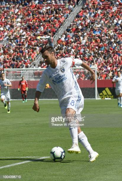 Chris Wondolowski of the San Jose Earthquakes dribbles the ball up the field against Manchester United during the second half of their exhibition...