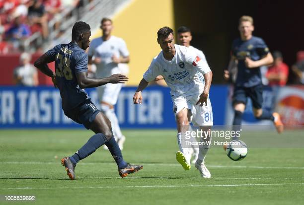Chris Wondolowski of the San Jose Earthquakes dribbles the ball up the field while defended by Axel Tuanzebe of Manchester United during the second...