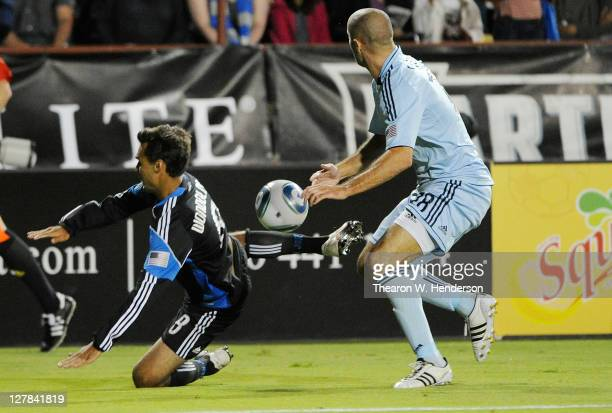Chris Wondolowski of the San Jose Earthquakes kicks the ball away from Aurelien Collin of the Sporting Kansas City in the second half during an MLS...