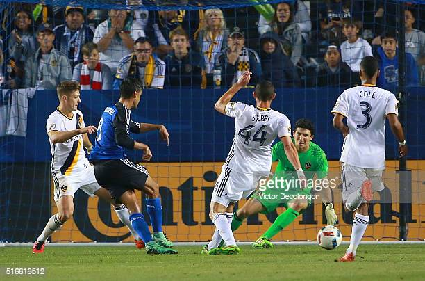 Chris Wondolowski of the San Jose Earthquakes scores late in the second half against goalkeeper Brian Rowe of the Los Angeles Galaxy during the MLS...