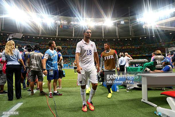 Chris Wondolowski of the United States walks off the pitch after the 12 defeat in the 2014 FIFA World Cup Brazil Round of 16 match between Belgium...