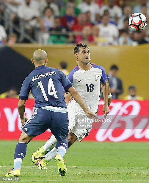 Chris Wondolowski of United States and Javier Mascherano of Argentina fight for the ball during the Semifinal match between United States and...