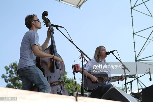 Chris Wood and Oliver Wood of The Wood Brothers perform during the Dave Matthews Band Caravan on Governors Island on August 26 2011 in New York City