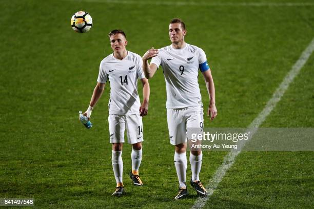 Chris Wood and Ryan Thomas of New Zealand walk off the field after the 2018 FIFA World Cup Qualifier match between the New Zealand All Whites and...