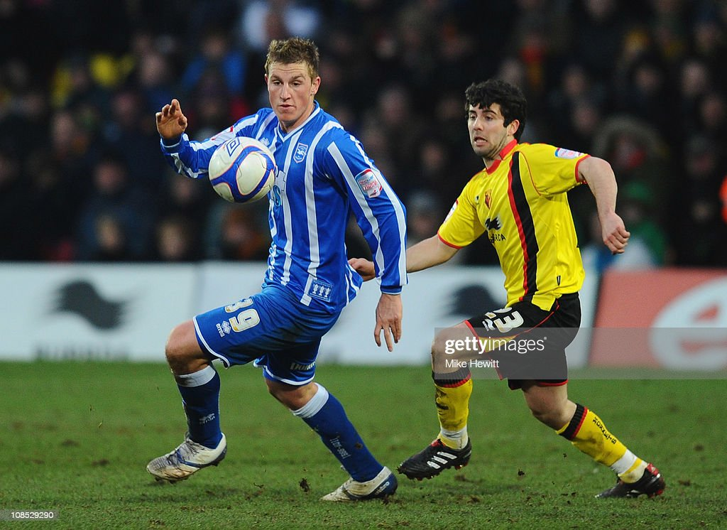 Chris Wood of Brighton is challenged by Piero Mingoia of Watford during the FA Cup Sponsored by E.ON 4th Round match between Watford and Brighton & Hove Albion at Vicarage Road on January 29, 2011 in Watford, England.