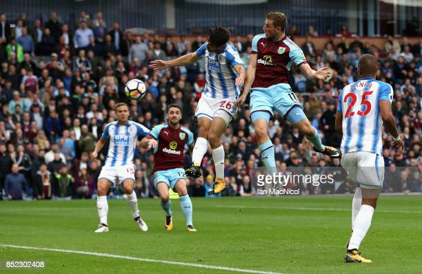 Chris Wood of Burnley and Christopher Schindler of Huddersfield Town compete for the ball during the Premier League match between Burnley and...