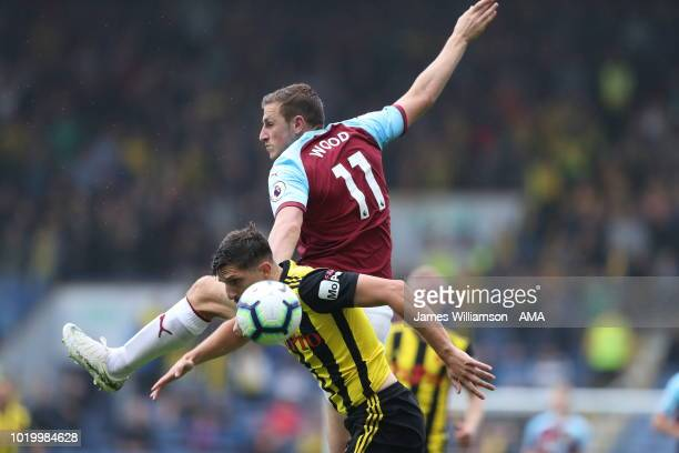 Chris Wood of Burnley and Craig Cathcart of Watford during the Premier League match between Burnley FC and Watford FC at Turf Moor on August 19 2018...