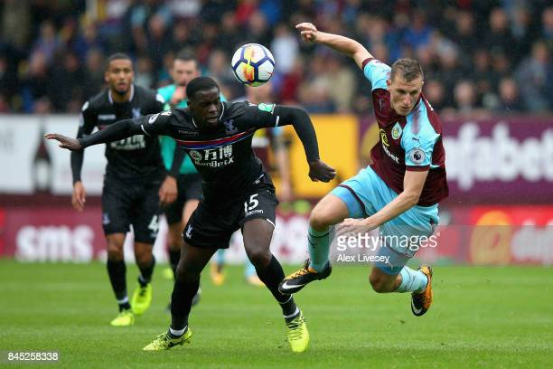 Chris Wood of Burnley and Jeffrey Schlupp of Crystal Palace in action during the Premier League match between Burnley and Crystal Palace at Turf Moor...