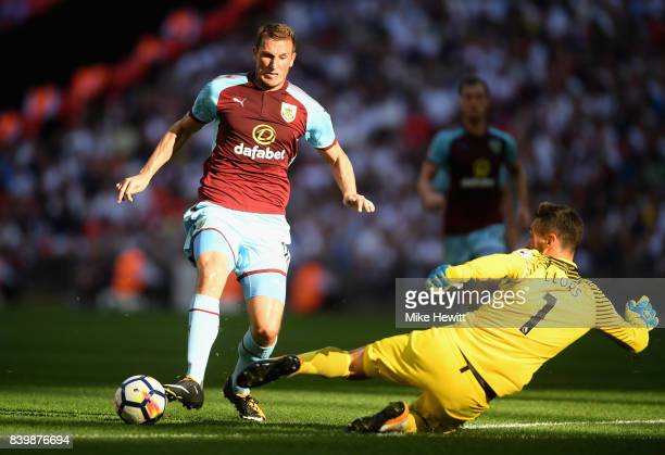 Chris Wood of Burnley attempts to take the ball past Hugo Lloris of Tottenham Hotspur during the Premier League match between Tottenham Hotspur and...