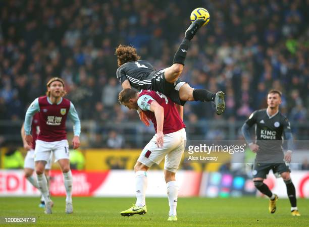Chris Wood of Burnley battles for possession with Caglar Soyuncu of Leicester City during the Premier League match between Burnley FC and Leicester...