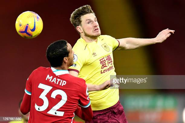 Chris Wood of Burnley battles for possession with Joel Matip of Liverpool during the Premier League match between Liverpool and Burnley at Anfield on...