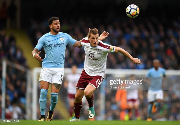 Chris Wood of Burnley battles with Kyle Walker of Manchester City during the Premier League match between Manchester City and Burnley at Etihad...