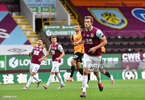 Chris Wood of Burnley celebrates after he scores his sides first goal from the penalty spot during the Premier League match between Burnley FC and...