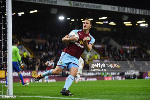 Chris Wood of Burnley celebrates after scoring a penalty during the Carabao Cup Third Round match between Burnley and Leeds United at Turf Moor on...