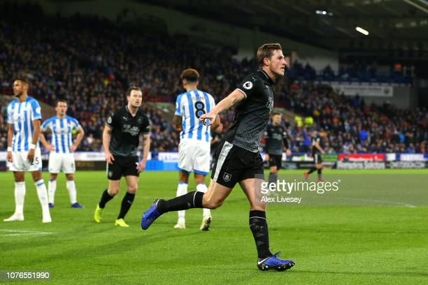 Chris Wood of Burnley celebrates after scoring his sides first goal during the Premier League match between Huddersfield Town and Burnley FC at John...