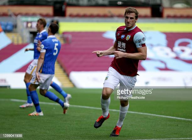 Chris Wood of Burnley celebrates after scoring his sides first goal during the Premier League match between Burnley FC and Brighton & Hove Albion at...