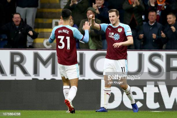 Chris Wood of Burnley celebrates after scoring his team's first goal with Dwight McNeil of Burnley during the Premier League match between Burnley FC...