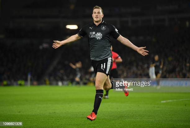 Chris Wood of Burnley celebrates after scoring his team's first goal during the Premier League match between Brighton Hove Albion and Burnley FC at...