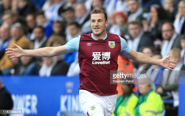 Chris Wood of Burnley celebrates after scoring his team's first goal during the Premier League match between Leicester City and Burnley FC at The...
