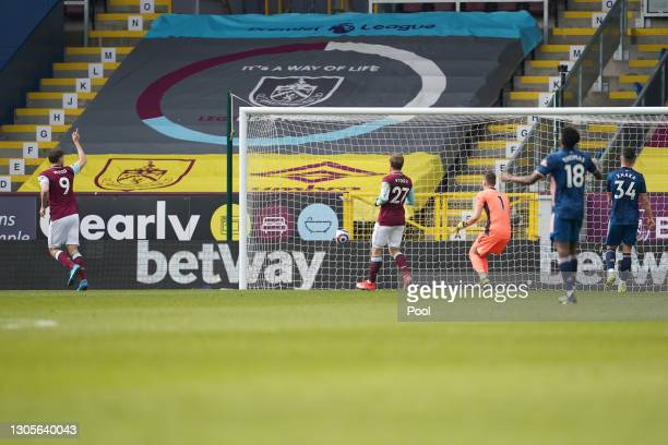 Chris Wood of Burnley celebrates after scoring his team's first goal past Bernd Leno of Arsenal during the Premier League match between Burnley and...