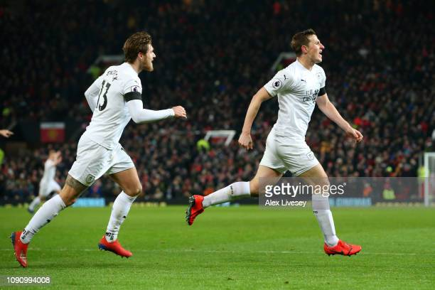 Chris Wood of Burnley celebrates after scoring his team's second goal with Jeff Hendrick of Burnley during the Premier League match between...