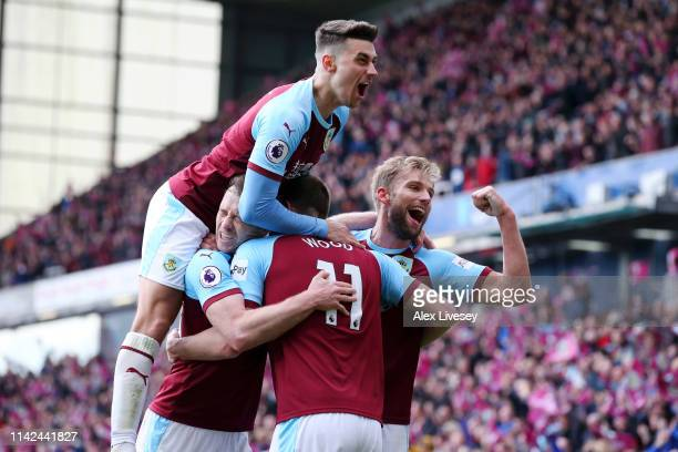 Chris Wood of Burnley celebrates after scoring his team's second goal with his team mates during the Premier League match between Burnley FC and...