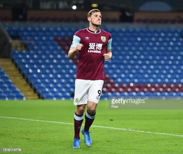 Chris Wood of Burnley celebrates after scoring their side's first goal during the Premier League match between Burnley and West Ham United at Turf...