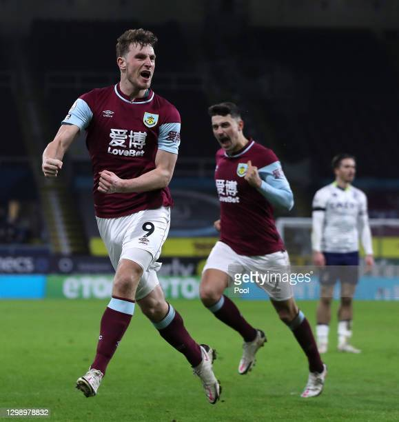 Chris Wood of Burnley celebrates after scoring their sides third goal during the Premier League match between Burnley and Aston Villa at Turf Moor on...