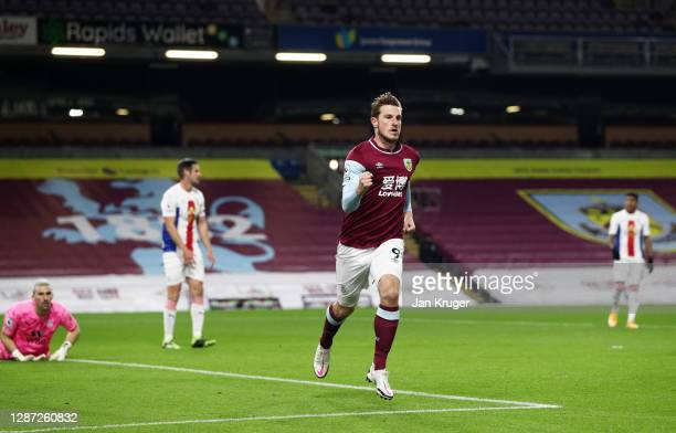 Chris Wood of Burnley celebrates after scoring their team's first goal during the Premier League match between Burnley and Crystal Palace at Turf...