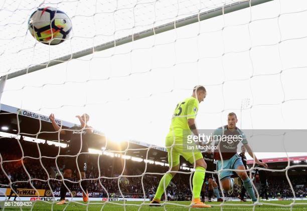 Chris Wood of Burnley celebrates scoring his sides first goal as Joe Hart of West Ham United reacts during the Premier League match between Burnley...